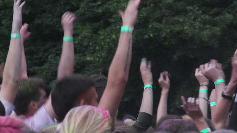 Many hands waving up in air, happy young people jumping, partying at festival Live Action
