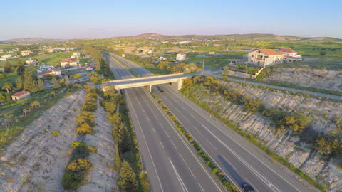 Aerial shot of active traffic on modern freeway. Beautiful landscape, horizon Footage
