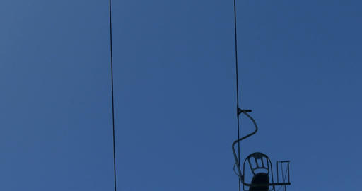 Close up of chair lift in the blue sky Footage