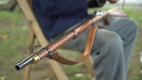 Civil War soldier cleans his rifle Footage