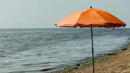 beach umbrella on an empty beach Footage