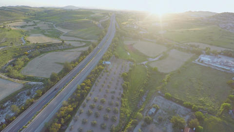 Busy traffic on road. Aerial shot of carefully cultivated farming land, gardens Footage