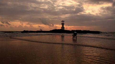 Lighthouse at sunset beach Footage