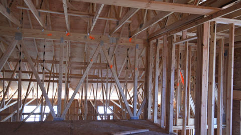 Unfinished attic of private house residential construction house framing agains Live Action