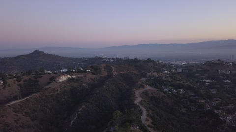 AERIAL: Over Hollywood Hills at Sunrise with view on hills and the valley and Live Action