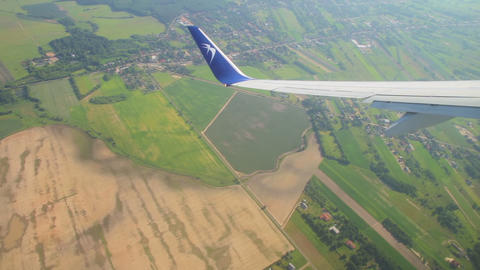 LOT Blue Air Polish Airlines commercial plane wing view from the window during flying on air Live Action