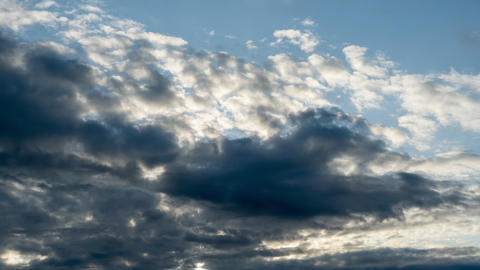 Clouds seamless dramatic uhd timelapse of gray nimbostratus clouds continuously looping from right Live Action