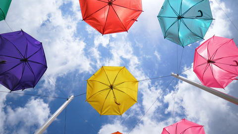 Colorful umbrella against sky background Live Action