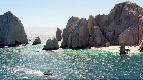 Slide Aerial of the Arch, Revealing View on Natural Arch, Landmark of Cabo Live Action