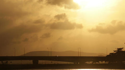 Cars rider crossing overpass the bridge with glowing sunrise Footage