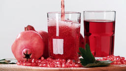 Pouring pomegranate juice into glass slow motion HD video. Still life fruits Footage