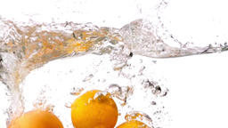 Oranges falling into water white background slow motion HD video. fruits splash  Footage