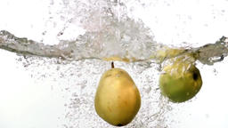 Pear apple grape falling into water white background slow motion HD fruits video Footage