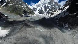 Flying over mountains ravine valley 4k video. Snow peak Caucasus Georgia Footage