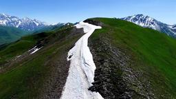 Flying over mountain snow range valley 4k travel video. Caucasus Georgia nature Footage