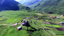 Ushguli mountain village 4k travel video. Aerial green valley church river Footage