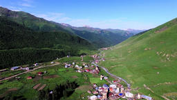 Ushguli mountain village 4k travel video. Aerial green valley church countryside Footage