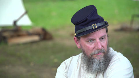 Civil War soldier sits near camp Footage
