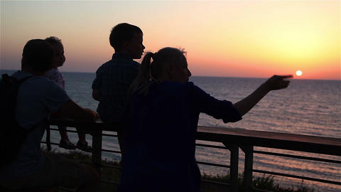 Silhouettes of a young family on a background of a sunset in the Mediterranean S Footage