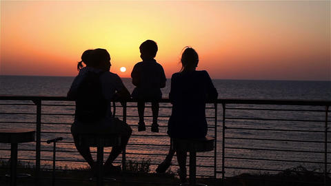 Family watching the sunset Footage