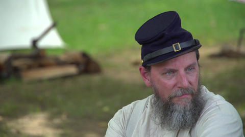 Civil War soldier sits alone in camp Footage