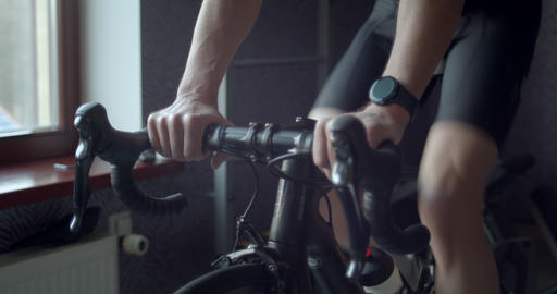 Adult man training on indoor smart bike trainer Live Action