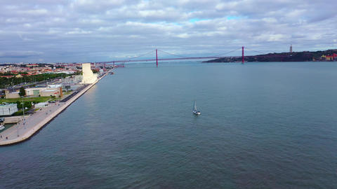River Tejo also called Tagus river in Lisbon with famous 25th April Bridge Live Action