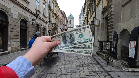 Three hundred dollar bills on blurred background of european Live Action