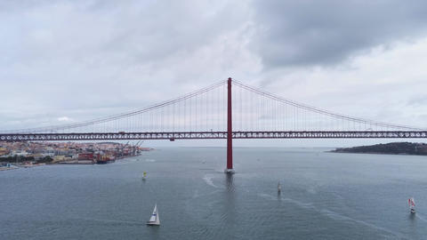 Aerial view over famous 25th of April Bridge at River Tejo in Lisbon Live Action