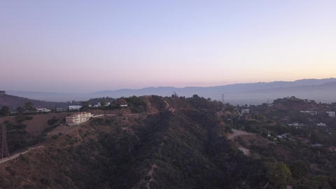 AERIAL: Over Hollywood Hills at Sunrise with view on hills and the valley in Los Live Action