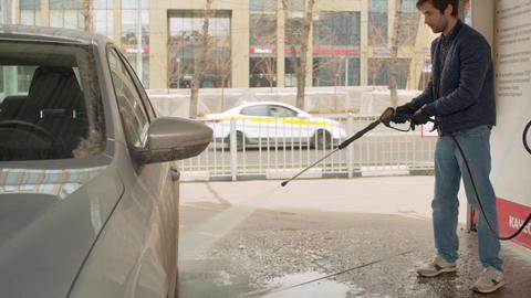 Handsome man washing car Live Action