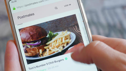Using Smartphone Buying in Internet Shop Ordering meal Online Store POV Live Action