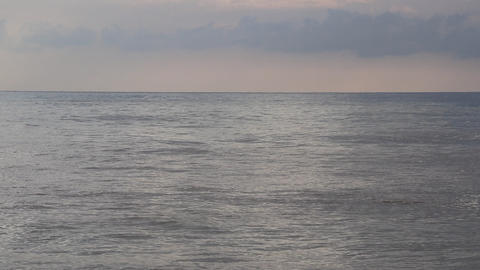 Calm sea waves on horizont with overcast weather on background. Alanya. Turkey Live Action