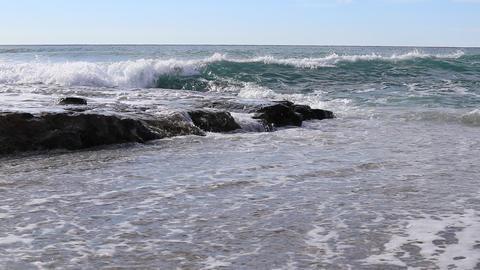 Calm splashing wave on rock shoreline seascape Live Action