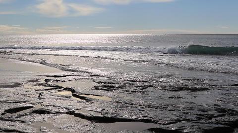 Calm splashing wave on rock shoreline in sunlight reflection seascape Live Action