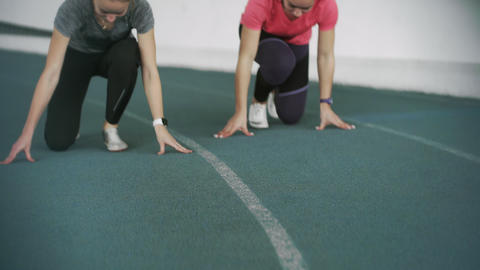 Two young female athlete with Track Shoes Spike Key Spike Key stands in low Live Action