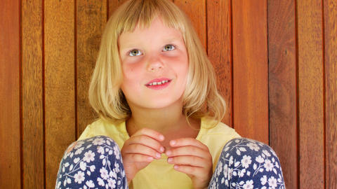 Preschooler girl looking at the camera and smiling Live Action