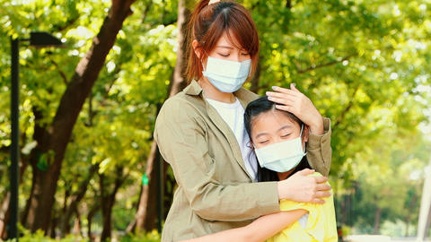 mother and child wear face mask during coronavirus and flu Live Action