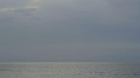 Time lapse of tranquil open sea with rippling water surface. Calm misty seascape Footage