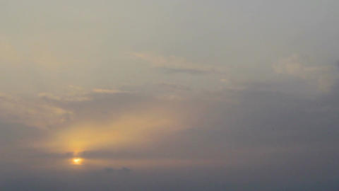Timelapse of sun rising behind clouds. Early hours of a new day. Fresh start Footage
