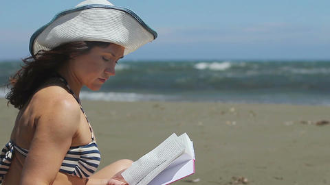 Brunette female reading book, enjoying hobby on summer vacation, storm at sea Footage