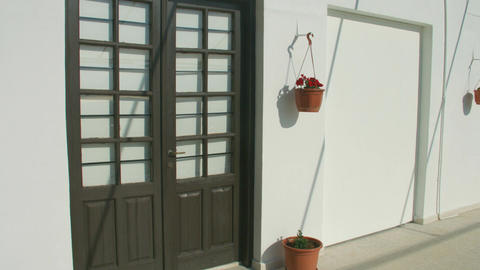 Vertical panorama of wooden doors in private house. Quiet resort town off season Footage