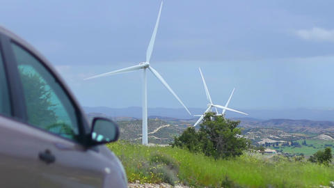 Car standing near wind farm, alternative power sources, fuel cost, energy crisis Footage