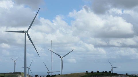 Time lapse of wind turbines rotating, thick stormy clouds flying, clean ecology Footage