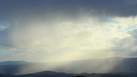 Haze in mountains, amazing natural beauty, sun rays, heaven on earth, silver sky Footage