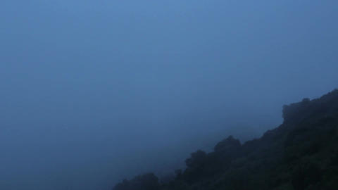 Mysterious dark place, dangerous hill covered with thick fog, scary atmosphere Footage