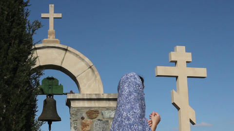 Young female saying prayers, looking at cross, asking God for help, religion Footage