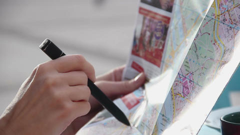 Close-up of female hands holding map, pencil, planning trip, holidays journey Footage