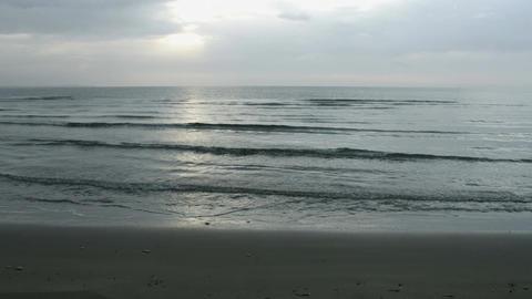 Timelapse of vast seascape under cloudy skyline. Ocean tide waves on sandy shore Footage