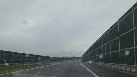 POV of car driver, driving in rain. Bad weather conditions, wet windscreen Live Action